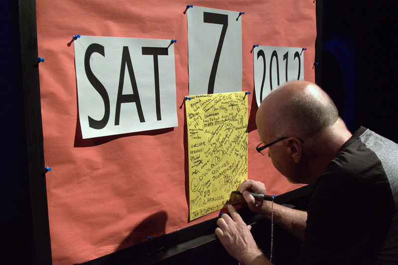 Peter, signing an envelope that is used for a trick during the show.