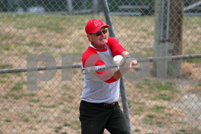 Senior playing softball.