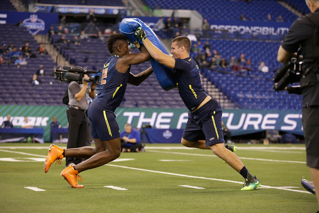 . Pittsburgh tight end Scott Orndoff, right, blocks Miami tight end David Njoku as they a drill at the NFL football scouting combine in Indianapolis, Saturday, March 4, 2017. (AP Photo/Michael Conroy)