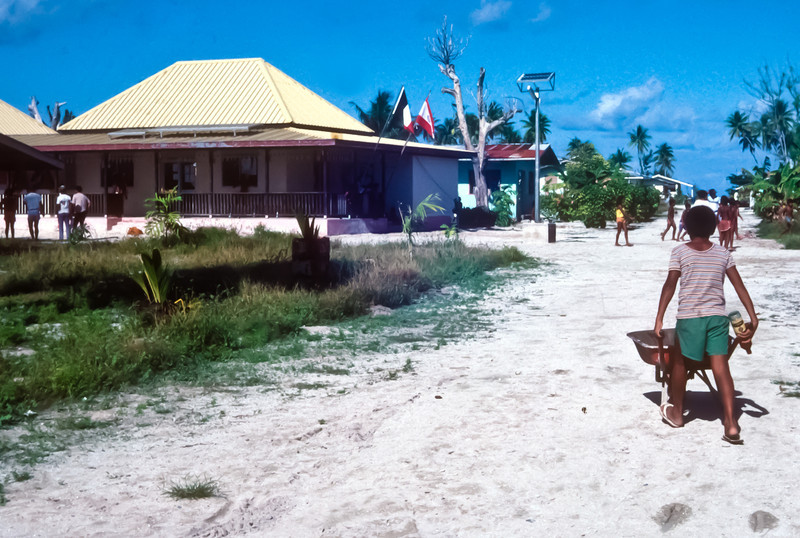 The new village of Ahe.  The entire island had been destroyed in 1883, 2 yearsago to a cyclone.  The French government had supplied the building materials to rebuild all the homes and the mayor's office.  Notice the solar powered street light at the mayor's office.