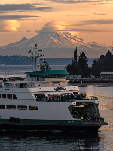 Lenticular clouds forming over Mount Rainier this evening, as the ferry M/V Tacoma pulls into Eagle Harbor (sporting its mustache for Movember).