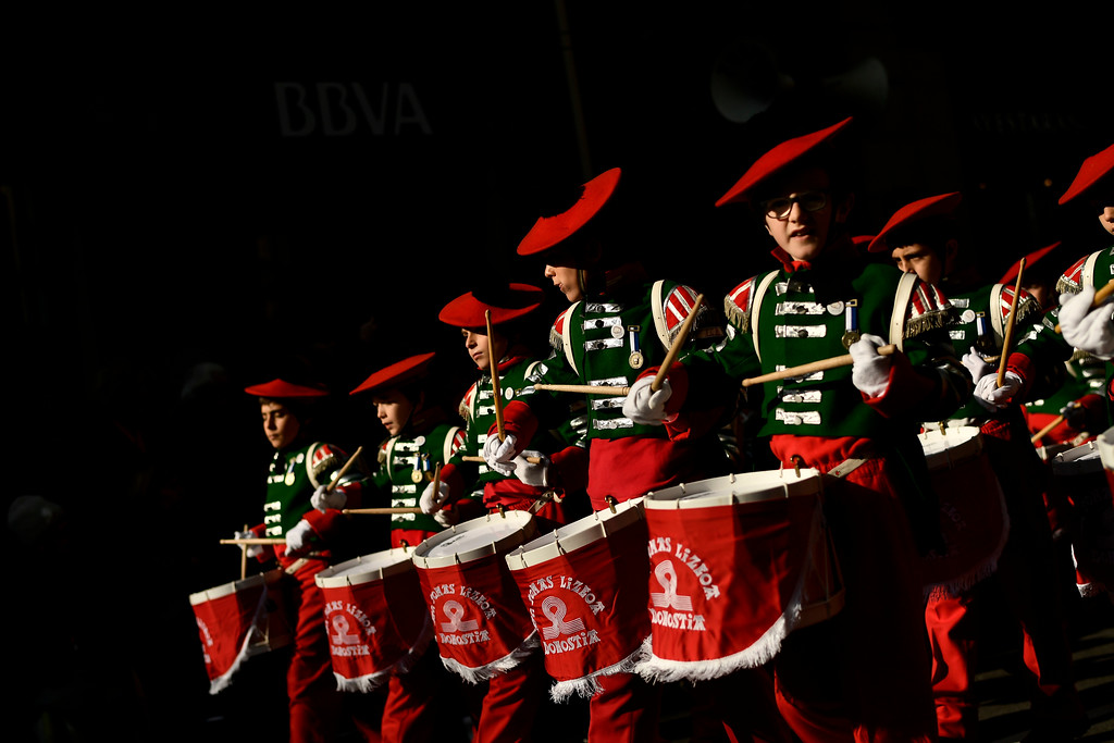 """. \""""Tamborilleros\"""" wearing their uniforms march in the traditional \' La Tamborrada\', during \'El Dia Grande\', the main day of San Sebastian feasts, in the Basque city of San Sebastian, northern Spain, Friday, Jan. 20, 2017. From midnight to midnight companies of perfectly uniformed marchers parade through the streets of San Sebastian playing drums and barrels in honor of their patron saint. (AP Photo/Alvaro Barrientos)"""