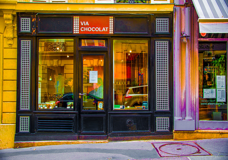 Working on photos I took in Paris in June. Here, reflections on chocolate, rue Jean-Baptiste Pigalle. I call it 'Vive Chocolat!', Paris, 2017. #leschocolatsd'auteurs #paris #viachocolat #cityscapes #colorscapes #flaneuse #colormechocolate #reflections