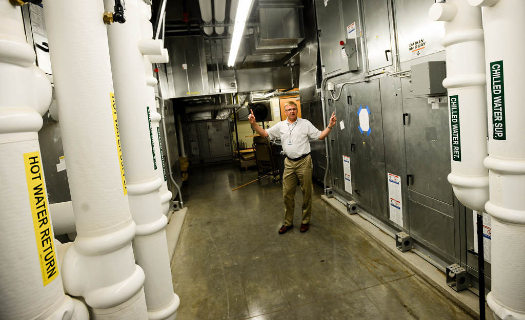 . Principal Mark Hamre shows the air-filtration system at the new Wildwood Elementary. �I think we�ve built a facility that really matches the quality of education we�ve been able to provide,� he said. (Pioneer Press: Ben Garvin)