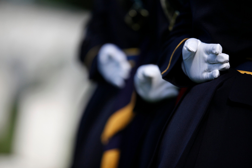 . U.S. Army honor guard members stand at the gravesite of Army Pvt. William Christman, who was the first military burial at the cemetery, marking the beginning of commemorations of the 150th anniversary of Arlington National Cemetery in Arlington, Va., Tuesday, May 13, 2014. (AP Photo)