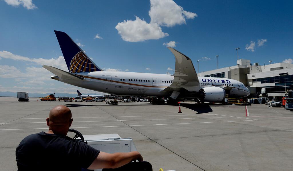 . United ramp agent, Jeff Larimer, admires a Boeing 787 Dreamliner preparing for departure at Denver International Airport in Denver, CO May 21, 2013. (Photo By Craig F. Walker/The Denver Post)