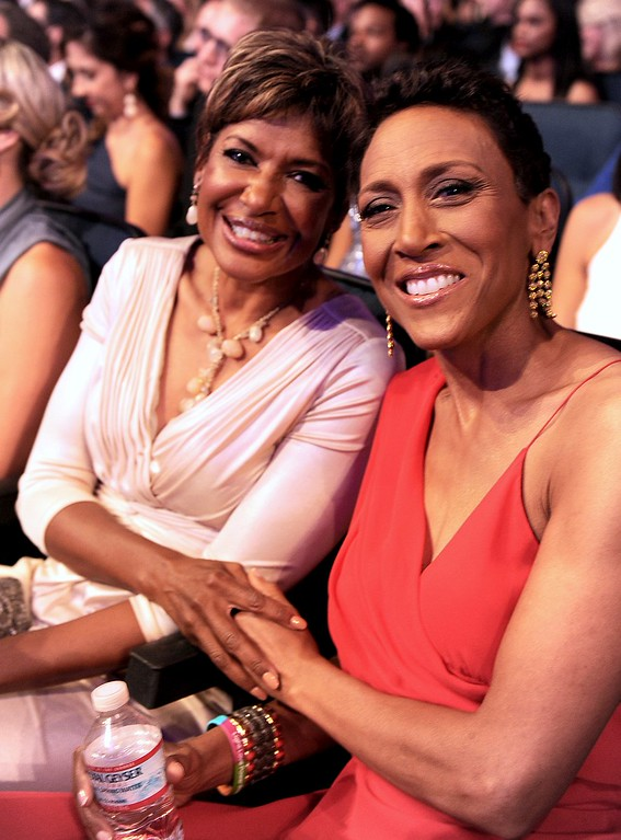 . Sally-Ann Roberts, left, and Robin Roberts pose in the audience at the ESPY Awards on Wednesday, July 17, 2013, at the Nokia Theater in Los Angeles. (Photo by Jordan Strauss/Invision/AP)