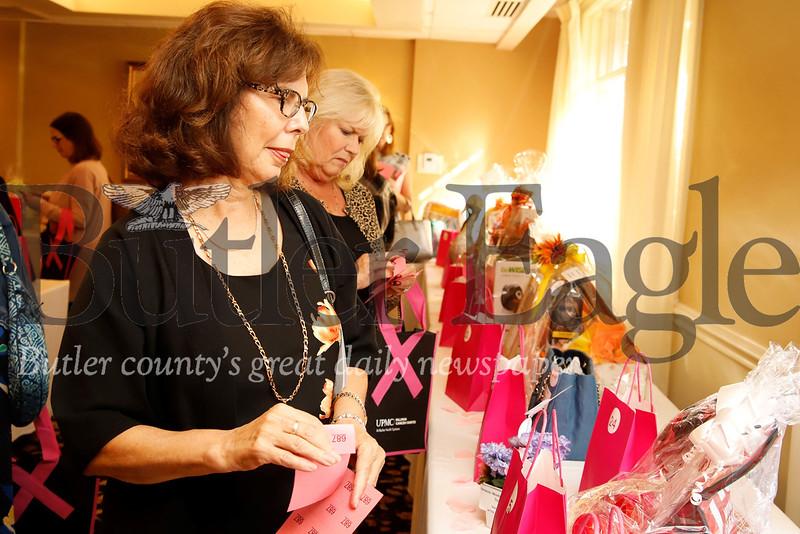 Ladies put raffle tickets in for raffle items. Seb Foltz/Butler Eagle