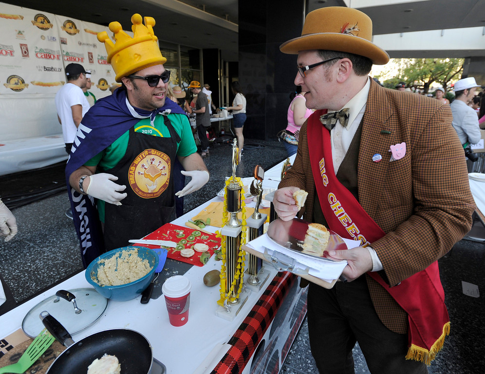 ". (l-r) Matt Laforest talks to the Big Cheese , aka Montano Sokolow, about the Angel food cake filled with cream cheese, rum and a wedge of kiwi fruit that he called, ""Hells Angel.\"" The 11th Annual Grilled Cheese Invitational was held Saturday at the Los Angeles Center Studios, 1201 W. 5th Street, in downtown. Cheese lovers came together to sample grilled cheese sandwiches in a variety of incarnations. Los Angeles, CA 4/20/2013(John McCoy/Staff Photographer"