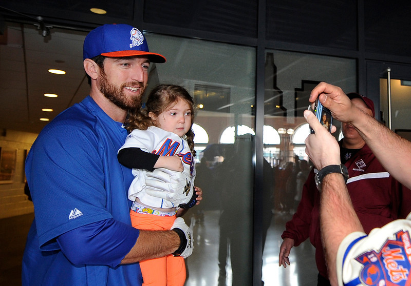 . New York Mets\' Ike Davis poses for a photograph with Alexa Kniss, 3, of East Meadow, N.Y.,  before the Opening Day baseball game against the San Diego Padres at Citi Field in New York,  Monday, April 1, 2013. (AP Photo/Kathy Kmonicek)