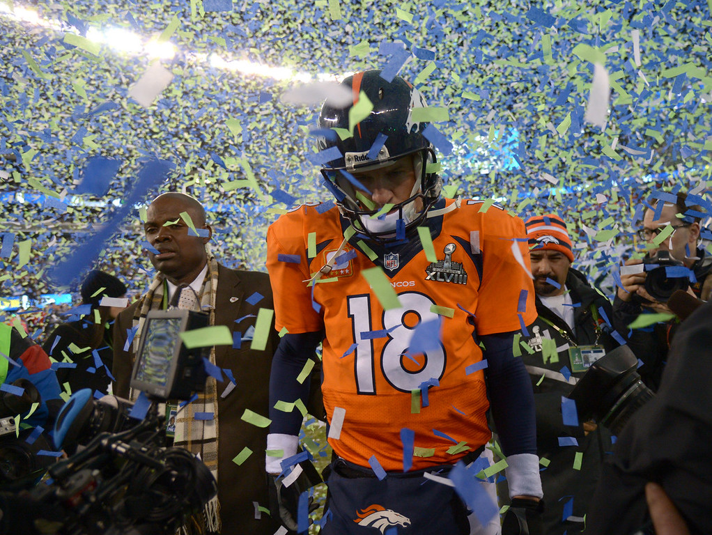 . Denver Broncos quarterback Peyton Manning (18) walks on the field after the Seattle Seahawks beat the Denver Broncos 43-8 in Super Bowl 48. The Denver Broncos vs the Seattle Seahawks in Super Bowl XLVIII at MetLife Stadium in East Rutherford, New Jersey Sunday, February 2, 2014. (Photo by John Leyba/The Denver Post)