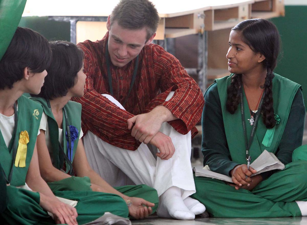 . Mount Madonna School senior Daniel Fust learns some words in Hindi from students at Pardada Pardadi School in Anupshahr, India on March 25.