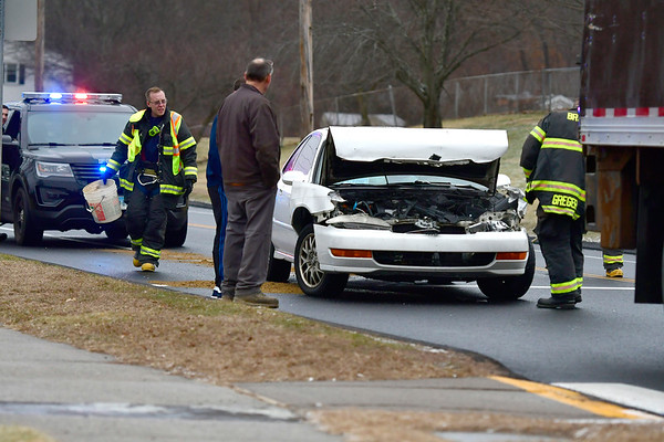 12/13/2018 Mike Orazzi || Staff The scene of a two-vehicle crash on Wolcott Street and Tuttle Road Thursday afternoon. No injuries were reported.
