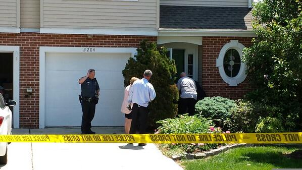 . Investigators take pictures and measurements of a neighboring home\'s door near the house where a woman was reportedly shot on Harvard Drive in Montgomery Township, Pa., Monday, June 2, 2014. (Photo by Dan Sokil)