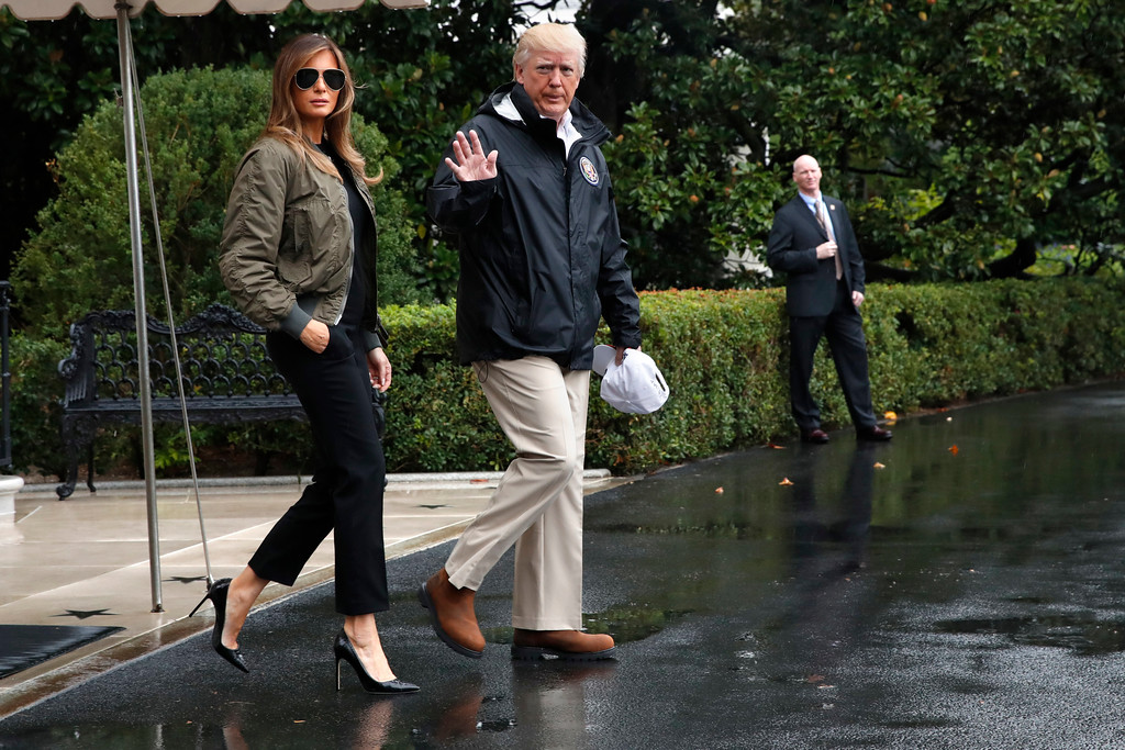 . President Donald Trump, accompanied by first lady Melania Trump, waves as they walk from the White House to the South Lawn, Tuesday, Aug. 29, 2017, to board Marine One for a short trip to Andrews Air Force Base, Md.m then onto Texas to view the federal government\'s response to Harvey\'s devastating flooding in Texas. (AP Photo/Jacquelyn Martin)