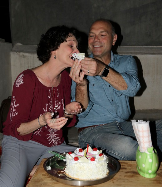 """When Rekha and her husband Rishi found out it was our anniversary they sent someone out and bought us a cake!!! Then made us do the """"feeding each other cake"""" thing!"""
