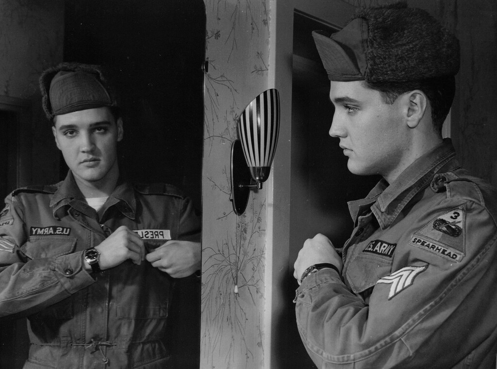 . Elvis Presley displays his Sergeants stripes in his home in Bad Nauheim, Germany, on Jan. 21, 1960. He was promoted to acting sergeant and squad leader in the 3rd armoured divisions 32nd armour scout platoon yesterday. His promotion doesnt mean a raise in pay. It is only temporary. As acting Sergeant Presley now commands a three-man reconnaisance team of his own. The singers service time is up in March. (AP Photo/Lindlar)