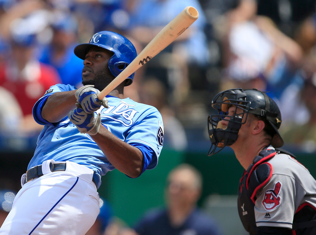 . Kansas City Royals\' Lorenzo Cain hits a two-run home run off Cleveland Indians starting pitcher Carlos Carrasco during the fifth inning of a baseball game at Kauffman Stadium in Kansas City, Mo., Saturday, June 3, 2017. Cleveland Indians catcher Yan Gomes, right, watches the play. (AP Photo/Orlin Wagner)