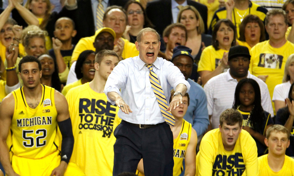 . Michigan Wolverines head coach John Beilein yells to his team as they play the Syracuse Orange in their NCAA men\'s Final Four basketball game in Atlanta, Georgia April 6, 2013. REUTERS/Tami Chappell