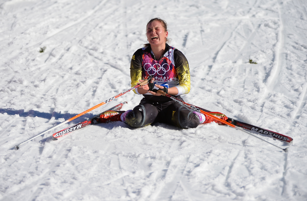 . Alexandra Camenscic of the Republic of Moldova collapses at the finish line in the Women\'s 10 km Classic during day six of the Sochi 2014 Winter Olympics at Laura Cross-country Ski & Biathlon Center on February 13, 2014 in Sochi, Russia.  (Photo by Harry How/Getty Images)