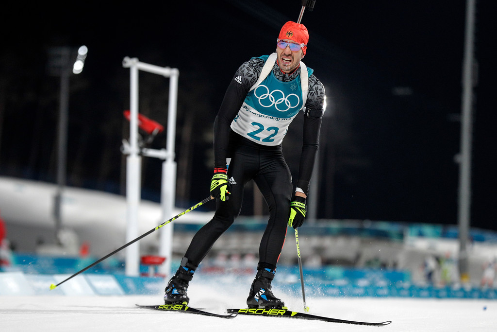 . Gold medalist Arnd Peiffer, of Germany, looks at his time as he arrives in the finish area during the men\'s 10-kilometer biathlon sprint at the 2018 Winter Olympics in Pyeongchang, South Korea, Sunday, Feb. 11, 2018. (AP Photo/Gregorio Borgia)