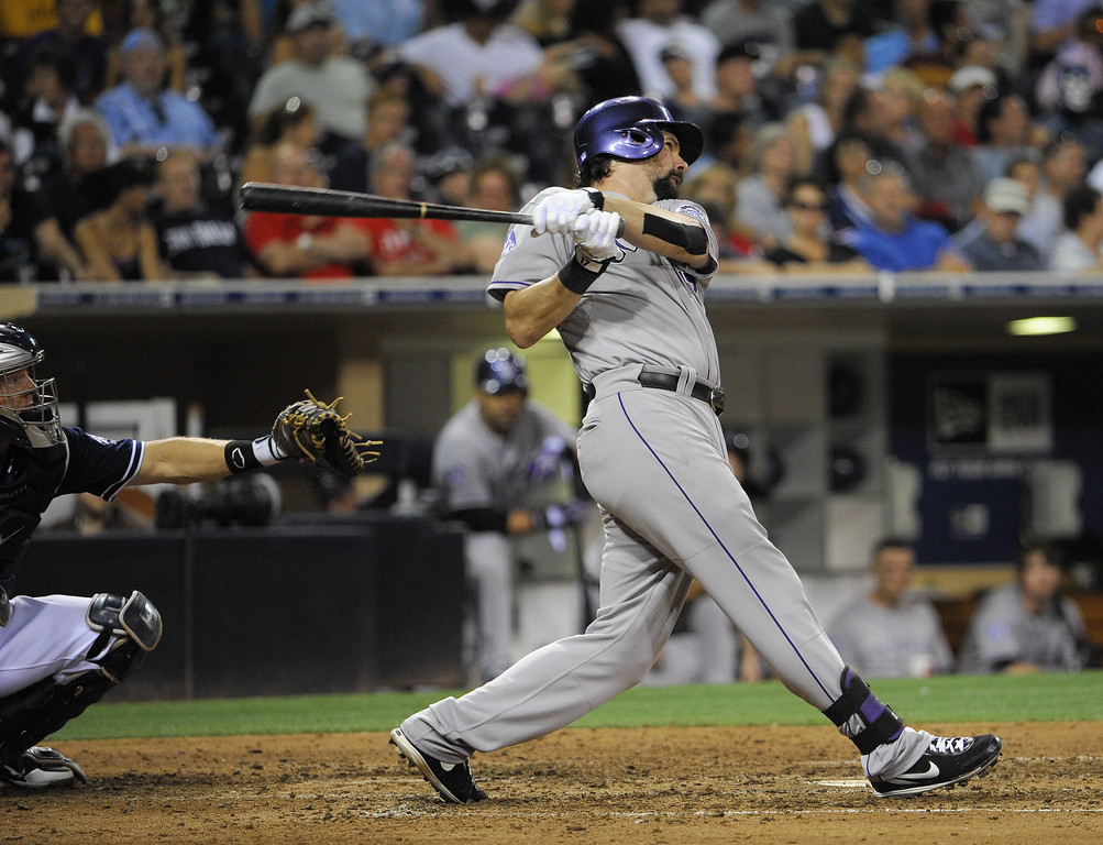 . SAN DIEGO, CA - SEPTEMBER 7:   Todd Helton #17 of the Colorado Rockies hits a double during the seventh inning of a baseball game against the San Diego Padres at Petco Park on September 7, 2013 in San Diego, California.  (Photo by Denis Poroy/Getty Images)