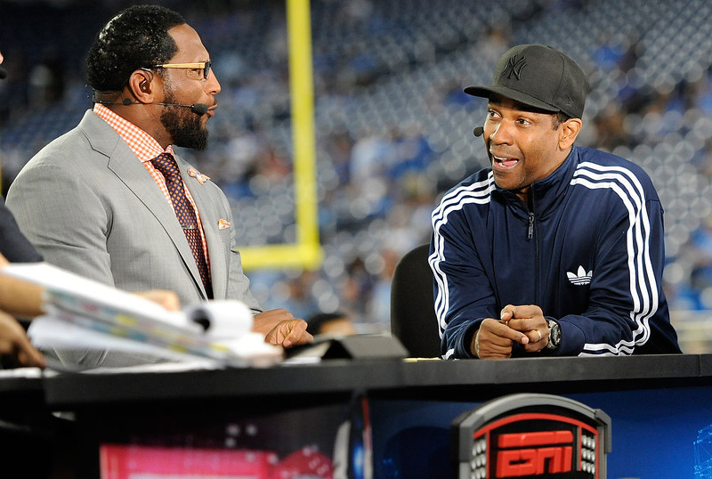 . Denzel Washington (R) and Ray Lewis talk prior to the start of NFL action between the Detroit Lions and New York Giants at Ford Field on September 8, 2014 in Detroit, Michigan. (Photo by Joe Sargent/Getty Images)
