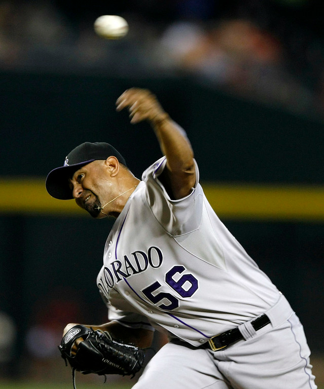 . Colorado Rockies starting pitcher Franklin Morales throws in the first inning during a baseball game against the Arizona Diamondbacks, Sunday, Aug. 10, 2014, in Phoenix. (AP Photo/Rick Scuteri)