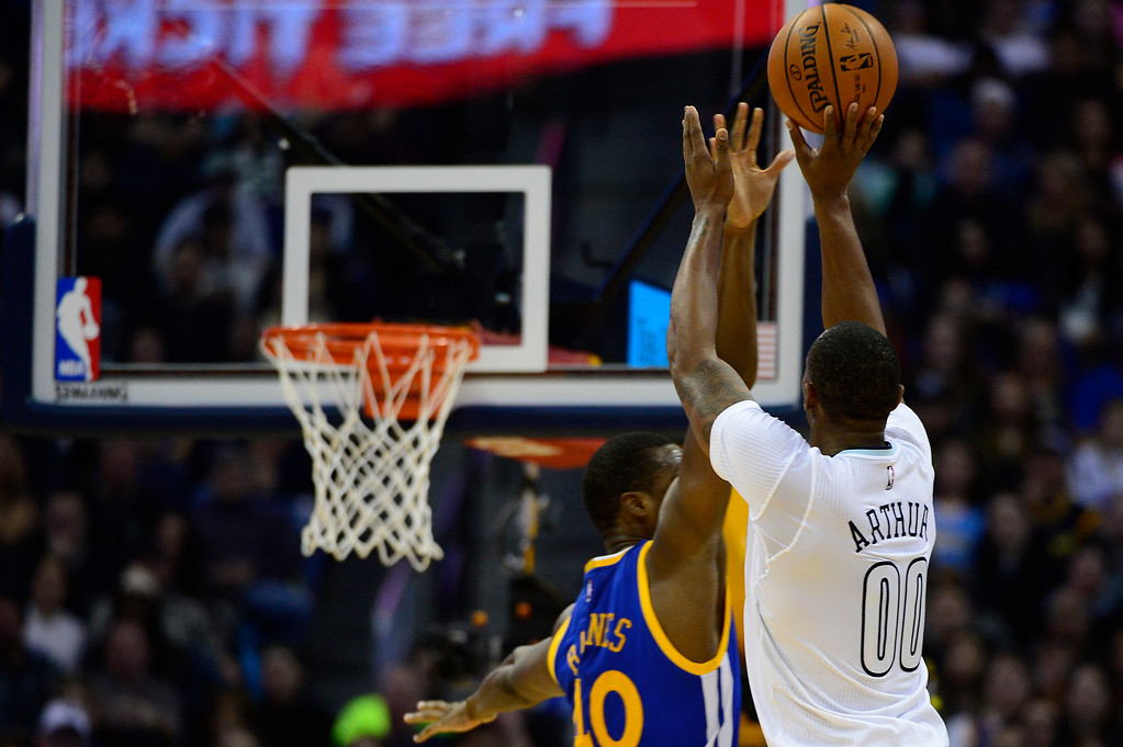 . DENVER, CO - JANUARY 13: Darrell Arthur (00) of the Denver Nuggets shoots over Harrison Barnes (40) of the Golden State Warriors for a three pointer during the second half at the Pepsi Center on January 13, 2016 in Denver, Colorado. The Nuggets defeated the Warriors 112-110, giving the Warriors their third loss of the season. (Photo by Brent Lewis/The Denver Post)