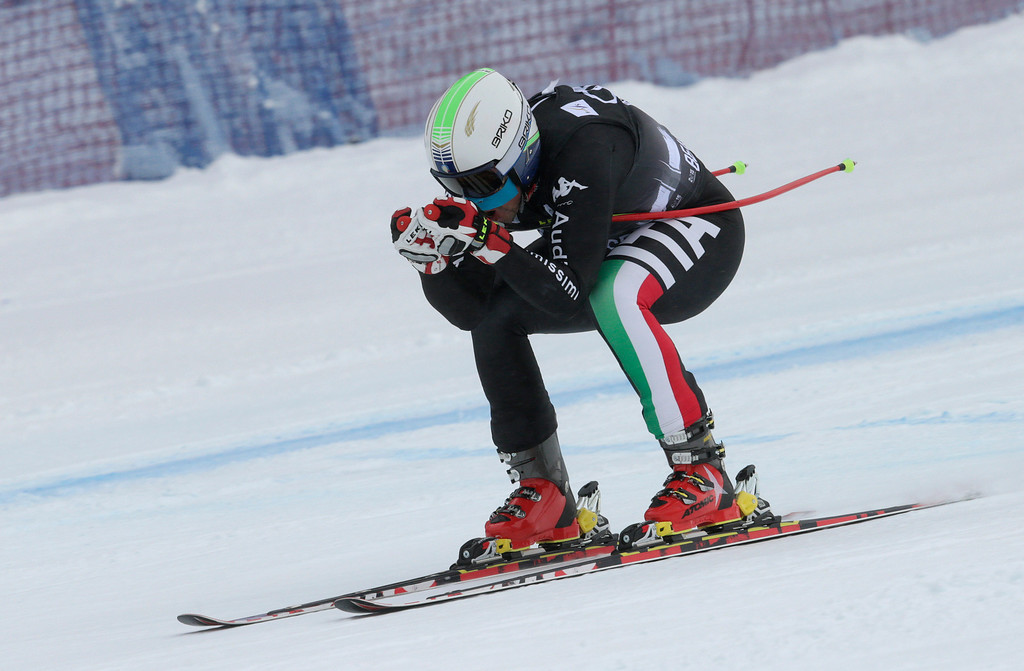 . Italy\'s Peter Fill heads for the finish line during the men\'s World Cup downhill skiing event, Friday, Dec. 6, 2013, in Beaver Creek, Colo. Fill placed third behind winner Aksel Lund Svindal of Norway and second place finisher Austria\'s Hannes Reichelt. (AP Photo/Charles Krupa)
