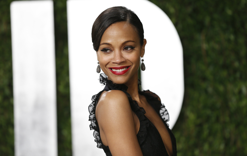 Description of . Zoe Saldana attends the 2013 Vanity Fair Oscars Party in West Hollywood, California February 24, 2013.  REUTERS/Danny Moloshok
