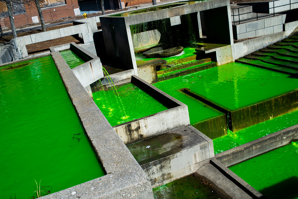 . Green water runs through the Grand Fountain in honor of St. Patrick\'s Day on Tuesday, March 17, 2015 at Riverbank Park in downtown Flint, Mich.  (AP Photo/The Flint Journal-MLive.com, Jake May)