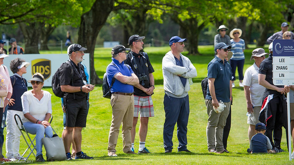 Spectators watch the tournament leaders coming down the 18th fairay on the final day of the Asia-Pacific Amateur Championship tournament 2017 held at Royal Wellington Golf Club, in Heretaunga, Upper Hutt, New Zealand from 26 - 29 October 2017. Copyright John Mathews 2017.   www.megasportmedia.co.nz