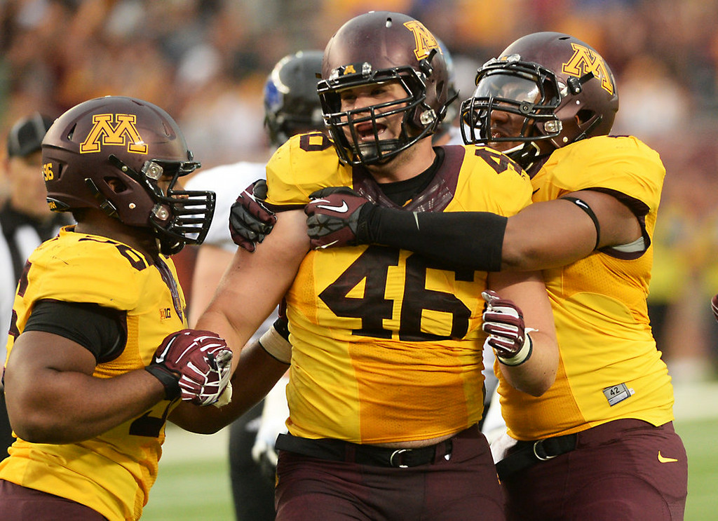 . Minnesota defensive lineman Cameron Botticelli, center, is congratulated by teammates after getting a sack on Eastern Illinois quarterback Jalen Whitlow in the second quarter.  (Pioneer Press: John Autey)