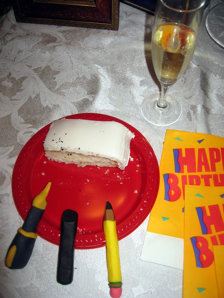 A slice of cake, with the drawing instruments.