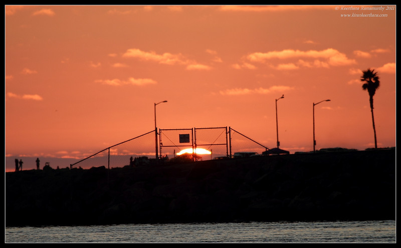 Sun setting behind the flood-channel gates, Robb Field, San Diego River, San Diego County, California, July 2011