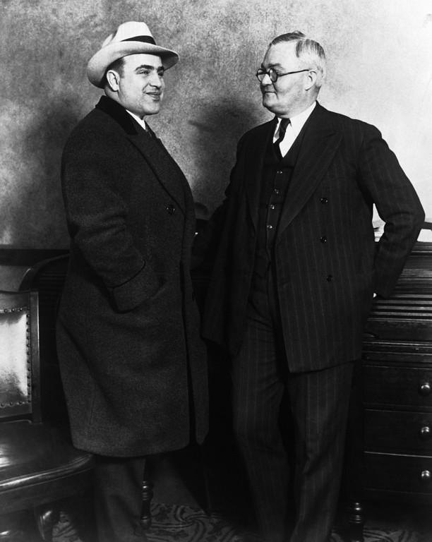 . Al Capone, the notorious American gangster, left, with John Stage, The Chief of Chicago\'s City Detectives pictured at the Chicago Police Headquarters after Capone was released from a jail in Philadelphia on March 31, 1930. (AP Photo)