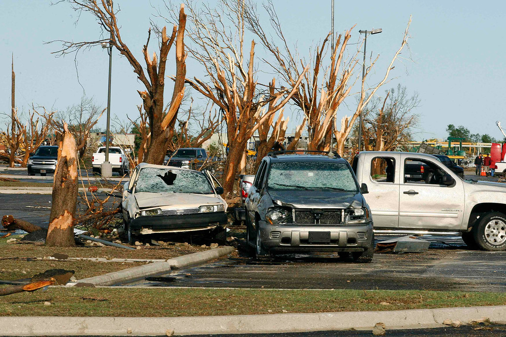 . Cars and trees damaged by a tornado are seen at Canadian Valley Technology Center in El Reno, Oklahoma June 1, 2013. Tornadoes killed five people in central Oklahoma including a mother and her baby and menaced Oklahoma City and its hard-hit suburb of Moore, before the storm system tracked northeast early on Saturday. REUTERS/Bill Waugh