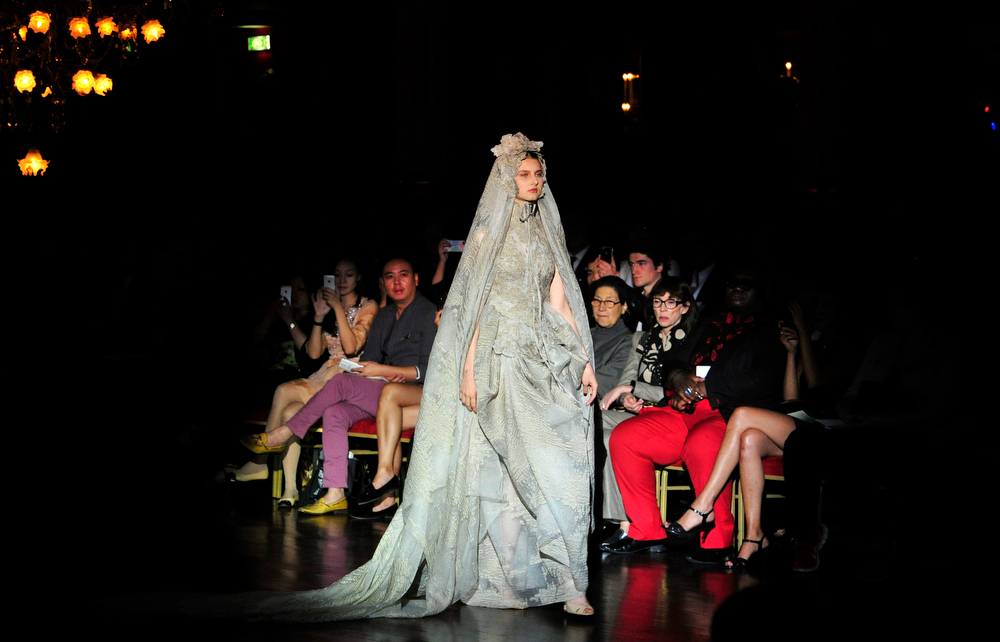 . A model wears the wedding gown for Frank Sorbier\'s  fall-winter 2014-2015 Haute Couture fashion collection in Paris, France, Wednesday, July 9, 2014. (AP Photo/Zacharie Scheurer)