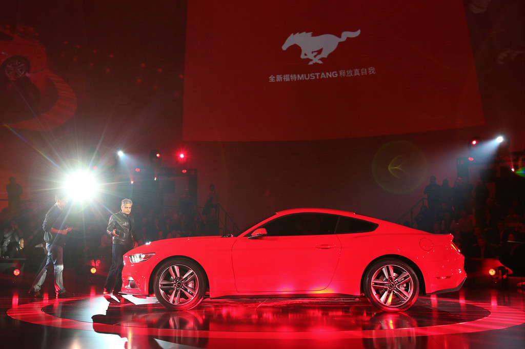. The latest Mustang of the Ford Motor Company is unveiled to the media at the All-New Ford Mustang Global Reveal event in Shanghai, China, Thursday, Dec. 5, 2013. (AP Photo/Eugene Hoshiko)