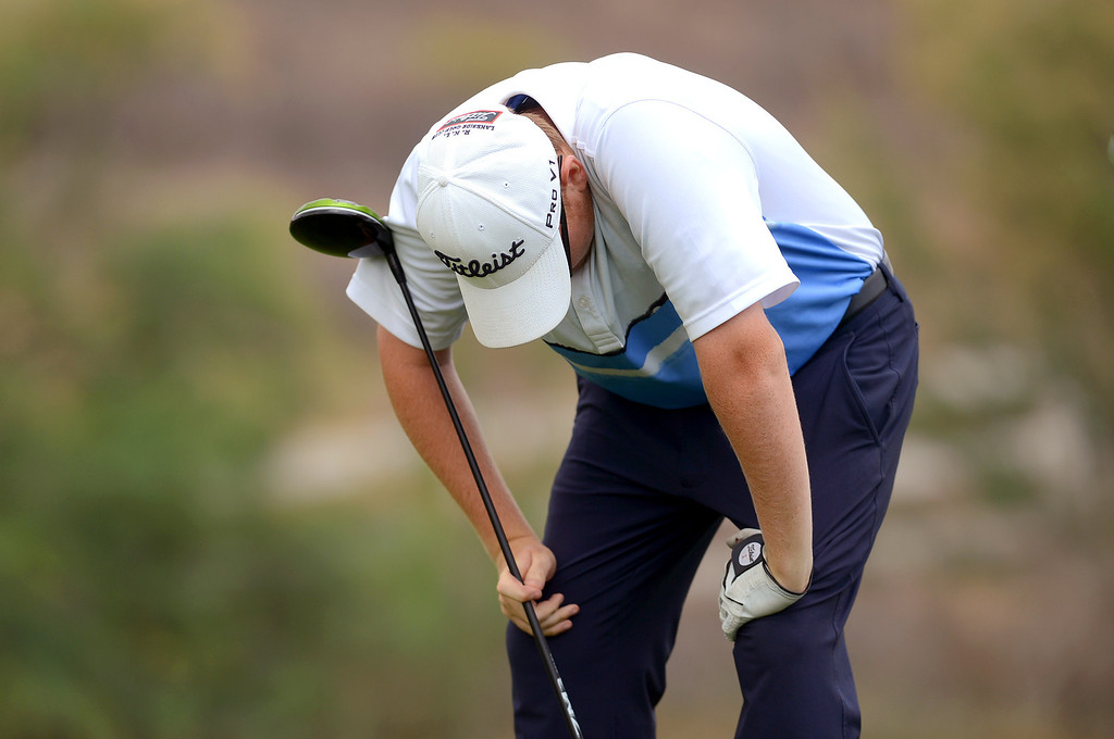 . Saugus High School\'s Braden Lewis reacts after hitting an errant tee shot while competing in the final round of the Foothill League Newhall Cup golf tournament at TPC Valencia April 24, 2013.(Andy Holzman/Staff Photographer)