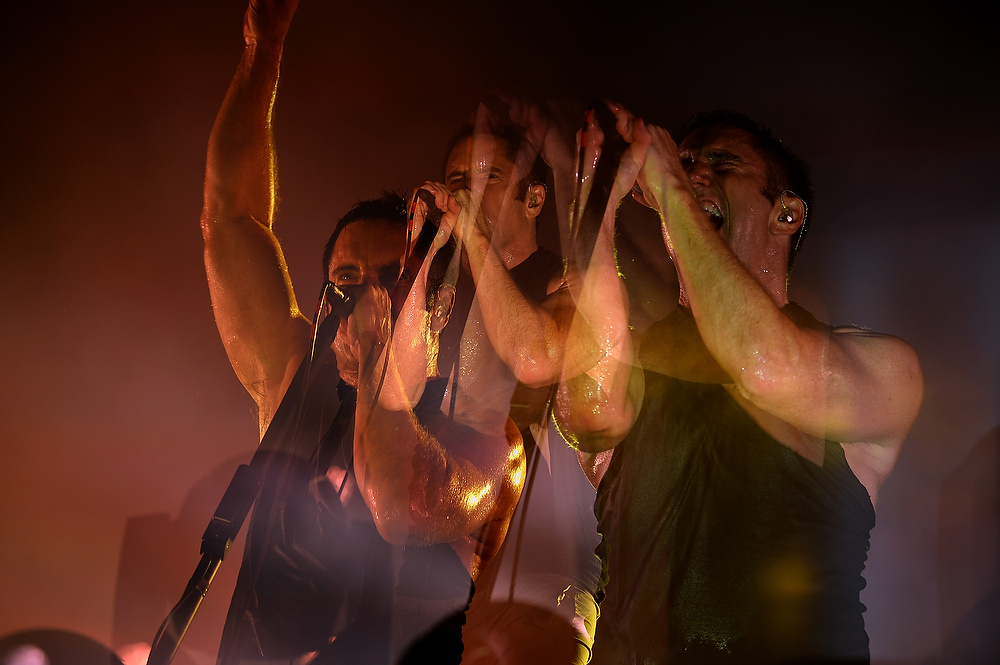 . CHICAGO, IL - AUGUST 02: (Editor\'s Note: Multiple exposeure made in camera) Trent Reznor of Nine Inch Nails performs during Lollapalooza 2013 at Grant Park on August 2, 2013 in Chicago, Illinois.  (Photo by Theo Wargo/Getty Images)