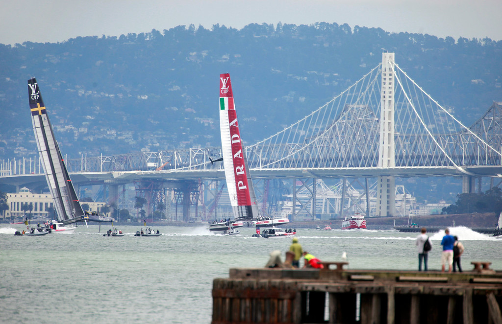 . Sweden\'s Artemis Racing and Italy\'s Luna Rossa sail against past the back drop of the new Bay Bridge in Race 2 of the  Luis Vuitton Cup semifinals on San Francisco Bay, Wednesday, August 7, 2013. (Karl Mondon/Bay Area News Group)