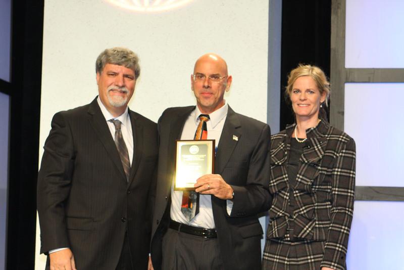 Brian and Award.JPG
