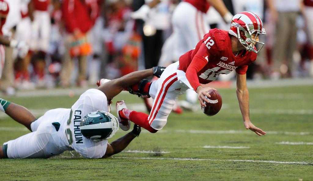 . Michigan State defensive end Shilique Calhoun (89) tackles Indiana quarterback Zander Diamont (12)  in the second half of an NCAA college football game in Bloomington, Ind., Saturday, Oct. 18, 2014.  Michigan State won the game 56-17. (AP Photo/Sam Riche)