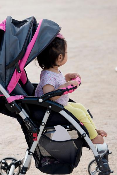 Baby girl sitting on stroller, Seoul, South Korea