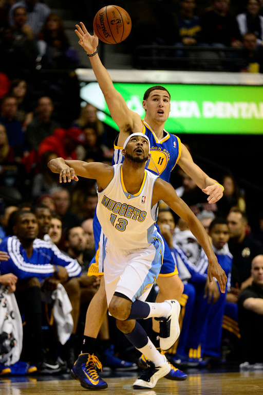 . Denver Nuggets small forward Corey Brewer (13) steals the ball from Golden State Warriors shooting guard Klay Thompson (11) during the first half at the Pepsi Center on Sunday, January 13, 2013. AAron Ontiveroz, The Denver Post