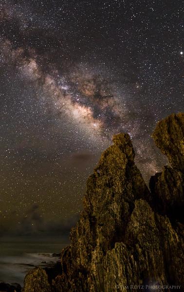 Milky Way and rock formations along the beach - Poipu,Kauai.