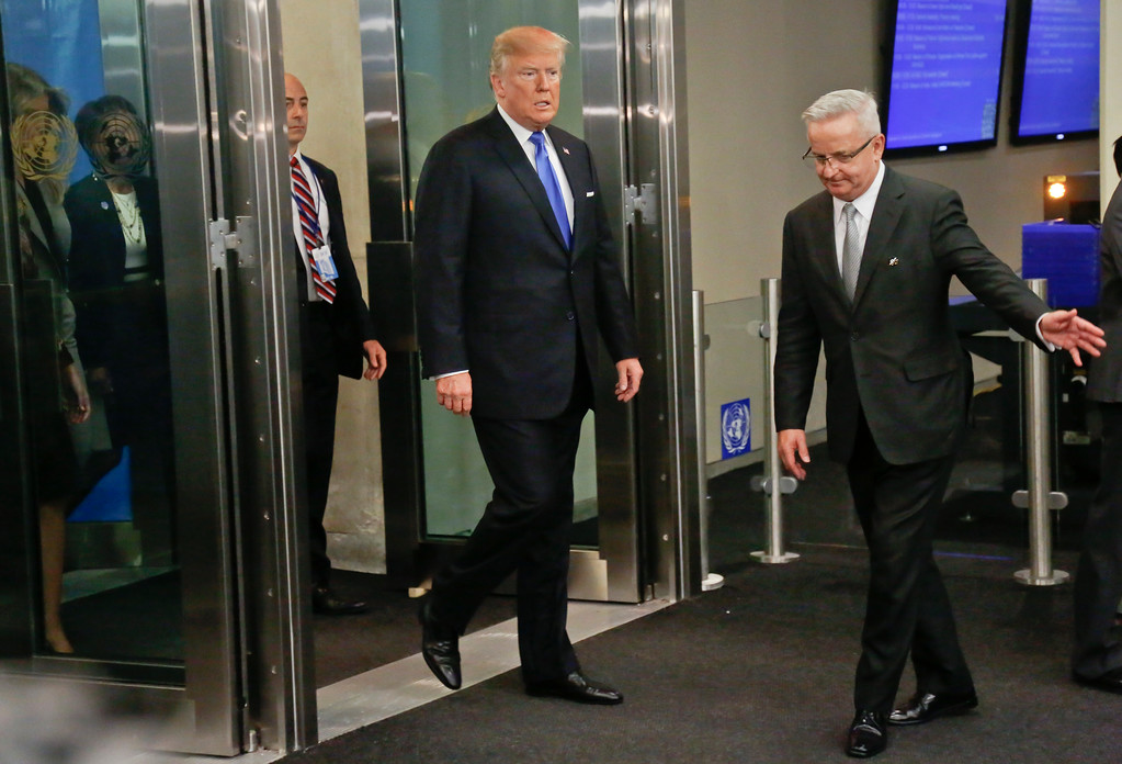 . U.S. President Donald Trump, center, arrives for the meeting of the United Nations General Assembly, Tuesday Sept. 19, 2017 at U.N. headquarters. (AP Photo/Bebeto Matthews)