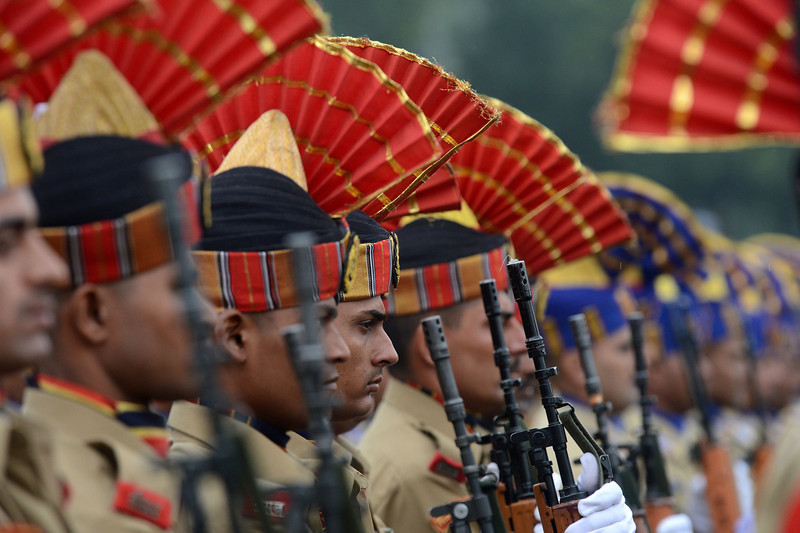 """. Indian Border Security Force (BSF) soldiers stand in formation during celebrations marking India\'s Independence Day at The Bakshi Stadium in Srinagar on August 15, 2013. Premier Manmohan Singh warned Pakistan August 15 against using its soil for \""""anti-India activity\"""", following a fresh escalation of tensions between the nuclear-armed neighbours over a deadly attack on Indian soldiers.  TAUSEEF MUSTAFA/AFP/Getty Images"""